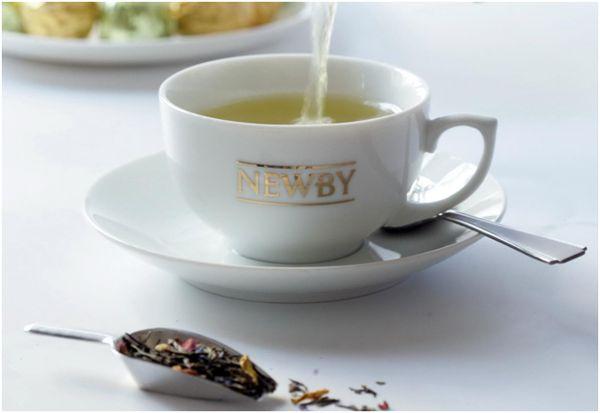 чай ньюби в фирменной чашке