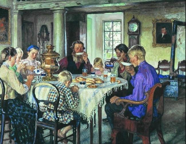 люди пьют чай за столом